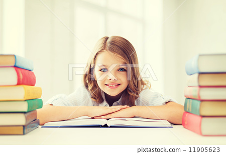 Stock Photo: smiling little student girl with many books