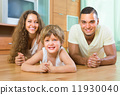 Happy couple with child at home 11930040