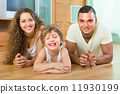 Happy couple with child at home 11930199