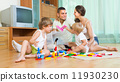 Family of four at home with toys 11930230