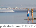 Surfers on Beach Having Fun in Summer. 11939117