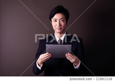 A businessman with a tablet 11961116