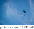 Parachutist over sky background 11991068