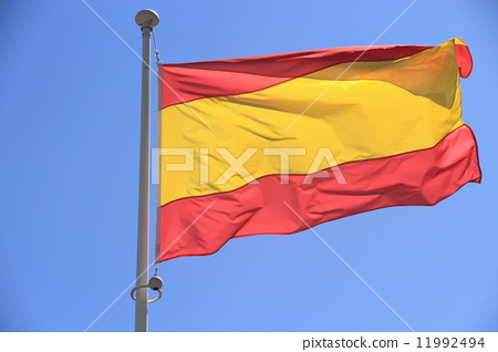 Spain flag without coat of arms to blue sky 11992494