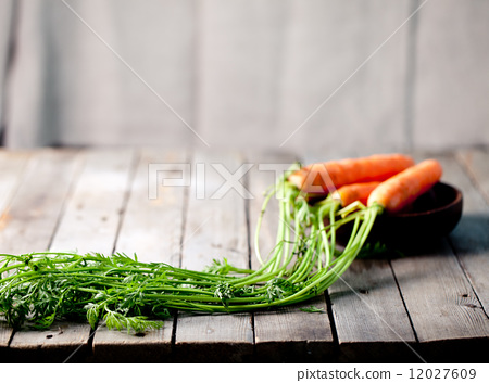 Fresh carrots in a wooden bowl 12027609