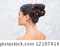 Pretty brunette with stylish up do 12107414