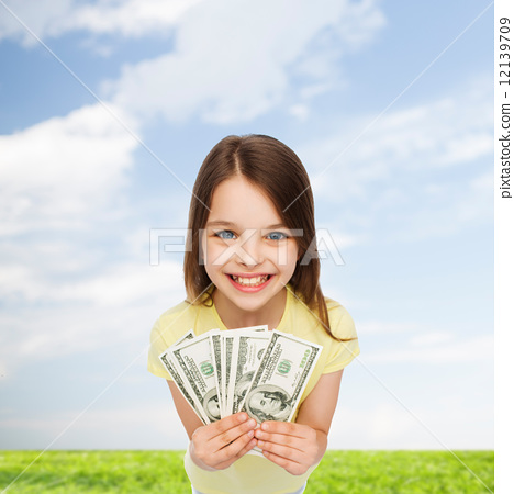 Stock Photo: smiling little girl with dollar cash money