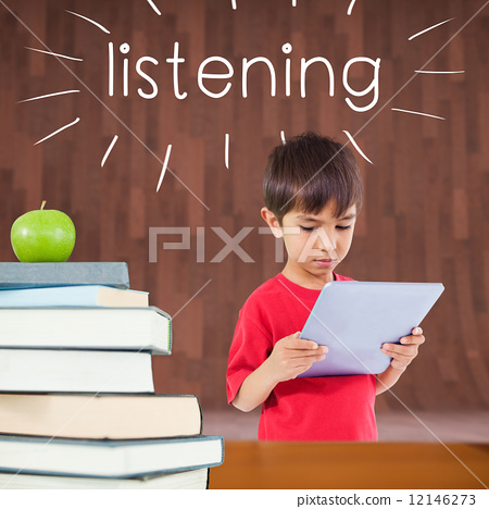 Stock Photo: Listening against red apple on pile of books