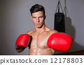 Serious muscular boxer in health club 12178803