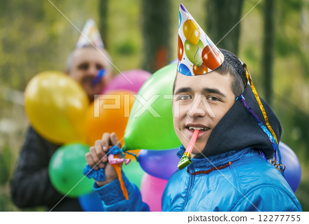 Boy with balloons in birthday party at outdoors  12277755