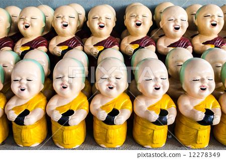 little buddhist monk dolls in temple,Thailand 12278349