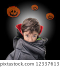 Little boy dressed up as Dracula for the halloween party 12337613