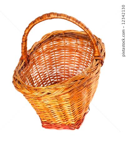 Empty wicker basket. Isolated on white background. 12342130