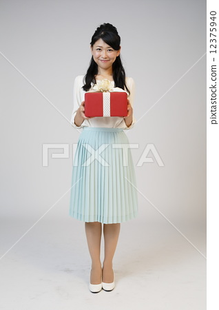 A young woman giving a gift 12375940