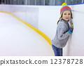 Little girl ice skating 12378728