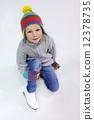 Little girl ice skating 12378735