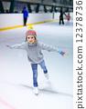 Little girl ice skating 12378736