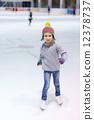 Little girl ice skating 12378737