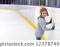 Little girl ice skating 12378740