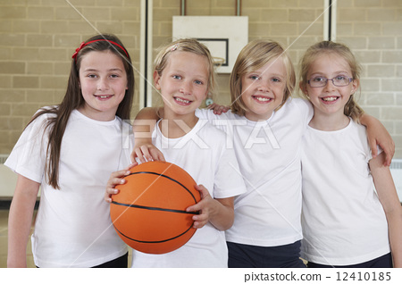 Stock Photo: Female School Sports Team In Gym With Basketball