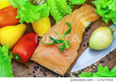 Salmon with various vegetables around  12424908