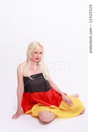 Young woman wrapped naked with Germany flag 12426329