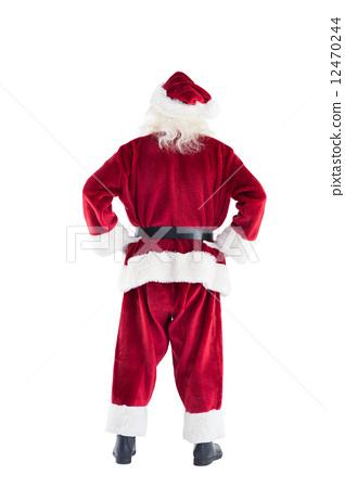 Santa shows the camera his back 12470244