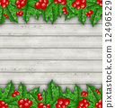 Christmas decoration holly berry branches on wooden background 12496529