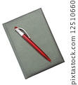 Red Pen on a dark notebook 12510660