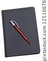 Red Pen on a dark notebook 12510676
