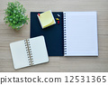 Blank notebook on the wood table - Top view 12531365