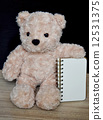 Bear doll and notebook on the wood table 12531375