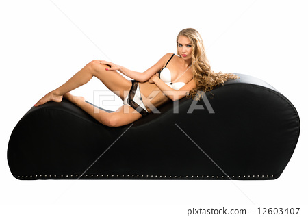 Sexy blond woman posing a tantra chair 12603407