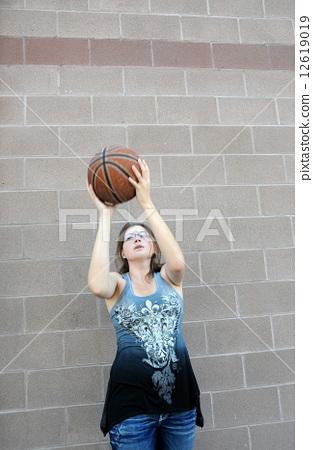 Female basketball player. 12619019