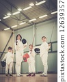 Children fencers and their  trainer 12639357