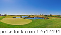 Summer panorama of the golf course. On the lake. 12642494