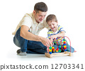 happy kid boy and dad playing toy 12703341