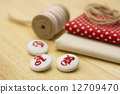 ผ้าและปุ่ม 12709470