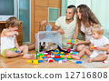 Family of four at home with toys 12716808