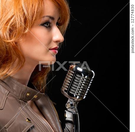 Beautiful redhead singer 12774830