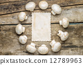 Mushrooms with blank paper sheet on wood background 12789963