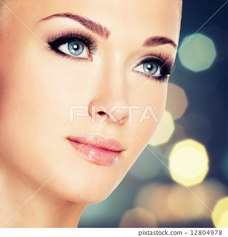 woman with beautiful blue eyes and long black eyelashes 12804978