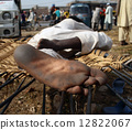Happy feet. A man relaxing outdoor, withi his feet dirty from wa 12822067