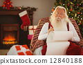 Relaxed santa writing list with a quill 12840188