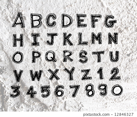 Hand drawn letters font written on wall texture background desig 12846327