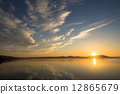 The sunset of Lake Saroma and the cloud weaving 12865679