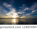 The sunset of Lake Saroma and the cloud weaving 12865680