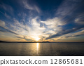 The sunset of Lake Saroma and the cloud weaving 12865681