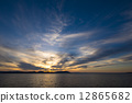 The sunset of Lake Saroma and the cloud weaving 12865682