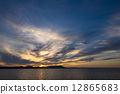 The sunset of Lake Saroma and the cloud weaving 12865683